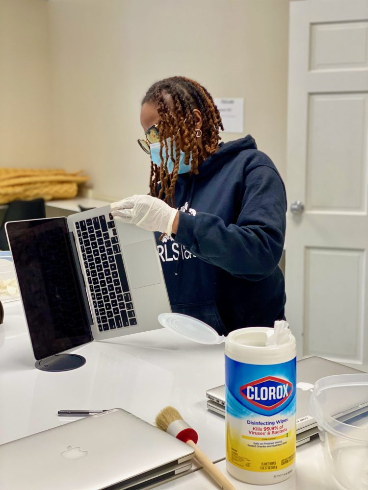 GFAC CEO Angela Patton cleaning laptops